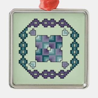 紫色およびティール(緑がかった色)の十字のステッチのオーナメント メタルオーナメント