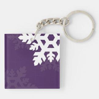 紫色に対する明るく、白い雪片 キーホルダー