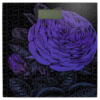 紫色の黒いパズルは上がりました 体重計