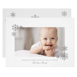 組み立てられたグリッターの雪片の新年の写真 カード