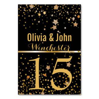 結婚式のテーブルは|にお祝いの黒い金ゴールドの星と番号を付けます カード