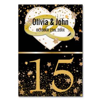 結婚式のテーブルは|にエレガントで黒い金の指輪と番号を付けます カード