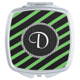 緑および黒いストライブ柄のモノグラムのコンパクトの鏡