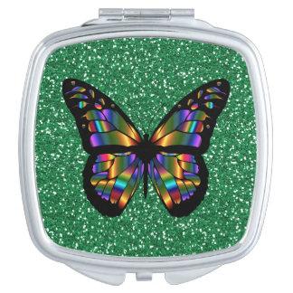 緑のグリッターのデザインのエレガントで抽象的な蝶