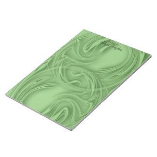 緑のテンプレート上のカール ノートパッド