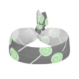 緑の棒つきキャンデーのヘアタイ ヘアタイ