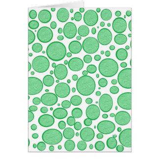 緑の泡によって緩和されるカード カード