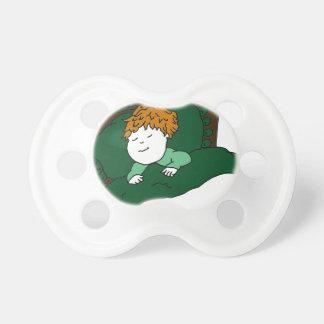 緑の睡眠の子供 おしゃぶり