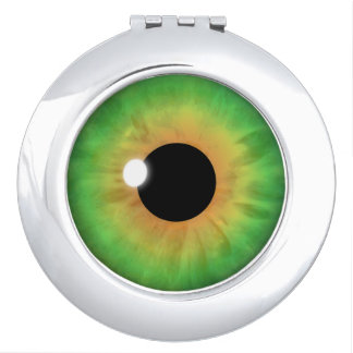 緑の瞳のアイリスカッコいいの眼球の円形のコンパクトミラー