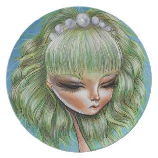 緑の花びらのかわいらしくポップ・アートのな超現実主義のプレート プレート