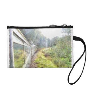 緑の草木を通した列車のヘッディング コインパース