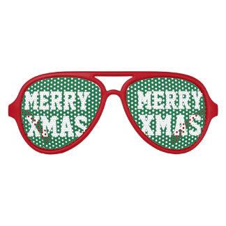 緑の赤いメリークリスマスのクリスマスのパーティの陰 アビエーターサングラス