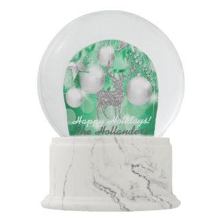 緑の《写真》ぼけ味のオーナメントの球の銀製のトナカイ スノーグローブ