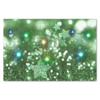 緑の《写真》ぼけ味の模造のなグリッター及びカラフルで輝くな星 薄葉紙