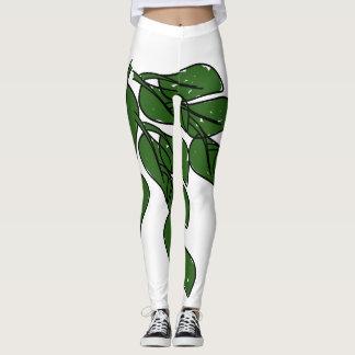 緑は白いレギングのアートワークを残します レギンス