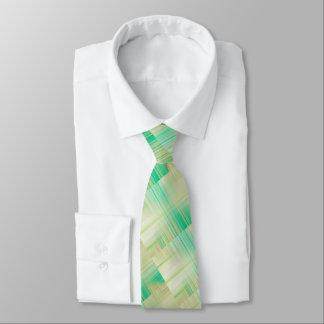 緑、ベージュ、およびクリーム色の刃の鋭い縞で飾ります タイ