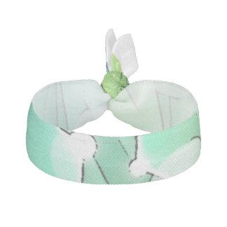 緑、青、白いフラクタルデザインのヘアタイ ヘアタイ
