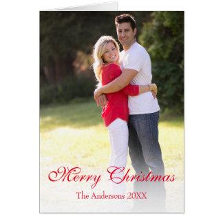 縦の写真の赤いメリークリスマスの挨拶状 カード