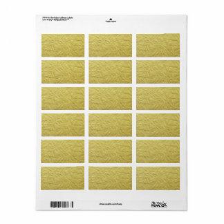 織り目加工の模造のな金ゴールドホイルの背景 ラベル