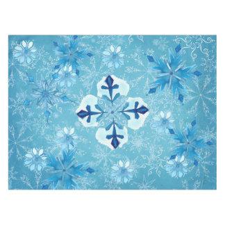 美しい氷った青い雪片のテーブルクロス テーブルクロス