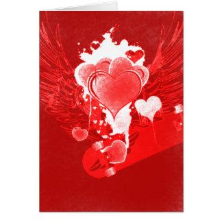 翼のスケートボードのバレンタインのカードが付いている赤いハート カード