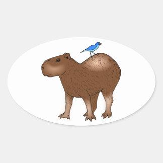背部の青い鳥を持つ漫画のカピバラ 楕円形シール