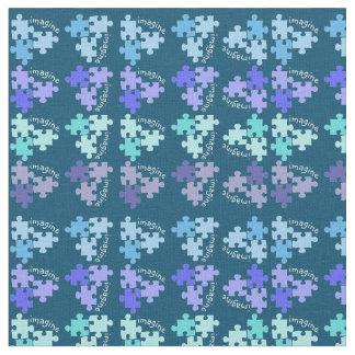 自閉症の認識度のパズルは青い陰を継ぎ合わせます ファブリック