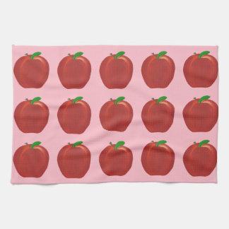 色彩の鮮やかで赤いりんごの緑は台所タオルを残します キッチンタオル