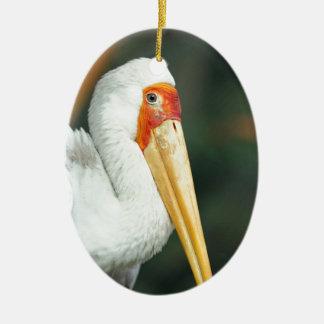 色彩の鮮やかなこうのとり(Mycteriaのleucocephala)の渡る鳥 セラミックオーナメント