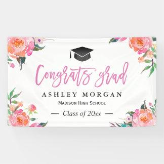 色彩の鮮やかなピンクの花のおめでとうの卒業生の卒業パーティー 横断幕