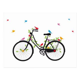 花および鳥が付いているヴィンテージの自転車 ポストカード