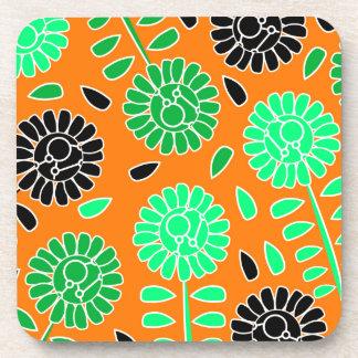 花のコントラストのオレンジ コースター