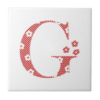花のパターン(の模様が)あるな手紙G (赤及び点) タイル
