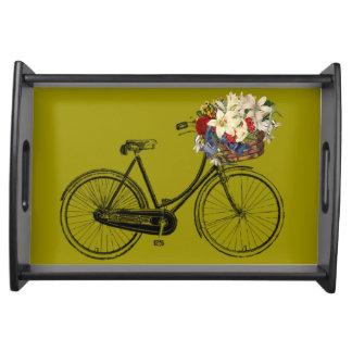 花のマスタードの黄色の皿が付いている自転車 トレー