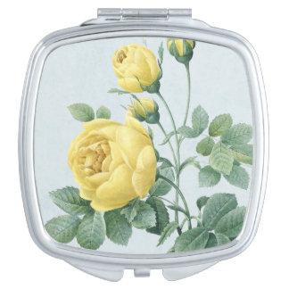 花のヴィンテージのコンパクトの鏡はとの上がりました