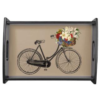 花の暗灰色の皿が付いている自転車 トレー