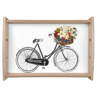 花の皿が付いている自転車 トレー