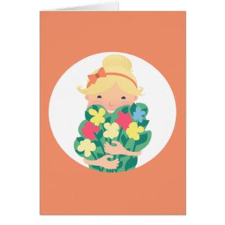 花の花束を持つ微笑の女の子 カード