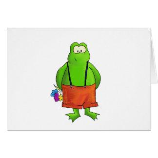 花を持つ内気な男の子のカエル カード