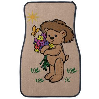 花を握っているブラウンのテディー・ベア カーマット
