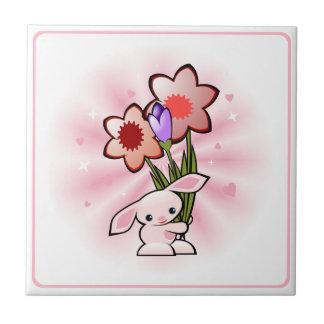 花イースターが付いているかわいいピンクのバニー タイル