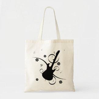 花パターンが付いている黒いエレキギター トートバッグ