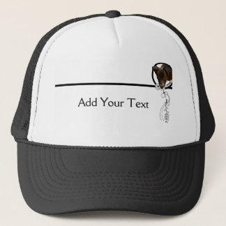 花フレームの帽子を通ってかいま見ている黒い子犬 キャップ