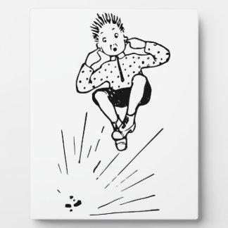 花火のイラストレーションと遊んでいる男の子 フォトプラーク