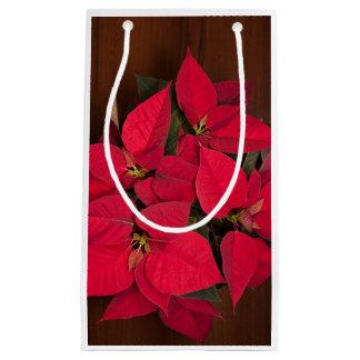 茶色木の赤いクリスマスの花 スモールペーパーバッグ