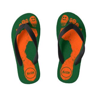 草色の野生オレンジの足跡のスマイリーToes™ キッズビーチサンダル