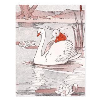 落ち着いた白鳥はウサギに上昇を与えます ポストカード