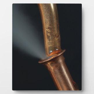 蒸気が付いている銅の管 フォトプラーク