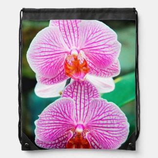 蘭のピンクのアジア花の花柄 ナップサック