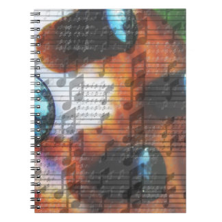 虎眼石の低音の積み込みのノブは音楽ノートの上で閉まります ノートブック